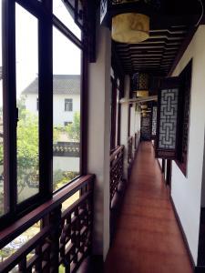 Suzhou Dongshan Xanadu Inn, Alloggi in famiglia  Suzhou - big - 81