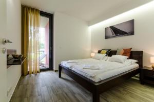 BalatonBee Apartman, Апартаменты  Балатонлелле - big - 15