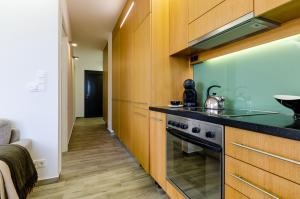 BalatonBee Apartman, Апартаменты  Балатонлелле - big - 18