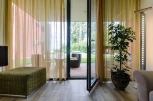 BalatonBee Apartman, Апартаменты  Балатонлелле - big - 23
