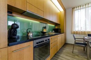 BalatonBee Apartman, Апартаменты  Балатонлелле - big - 24