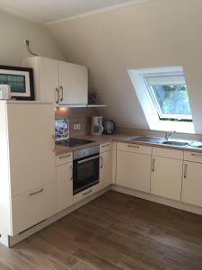 Huus-Windroos-Wohnung-2, Apartments  Ditzum - big - 3