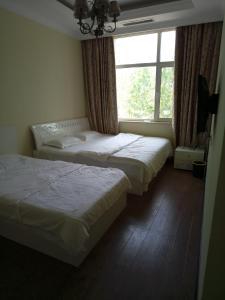 南戴河海岸别苑别墅, Vily  Qinhuangdao - big - 1
