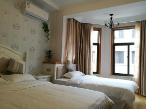 Fisherman and Sea Inn, Homestays  Zhoushan - big - 13