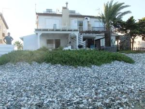 A Picture of Holiday house on the beach