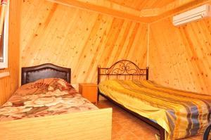 Guest House Mandarin, Affittacamere  Alakhadzi - big - 9