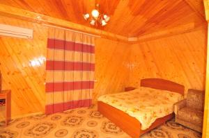 Guest House Mandarin, Affittacamere  Alakhadzi - big - 11