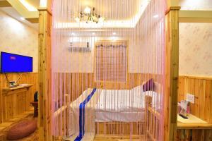 Zhaoxiahong Art hotel, Alloggi in famiglia  Wujiaqiao - big - 11