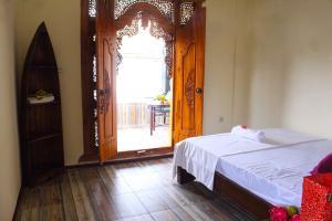 Parmini Guest House (formerly Internal Pelangi 2 Guesthouse), Penziony  Ubud - big - 10