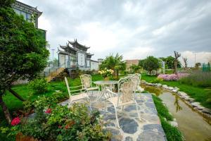 Dali Bai Cao Garden Theme Inn, Alloggi in famiglia  Dali - big - 104