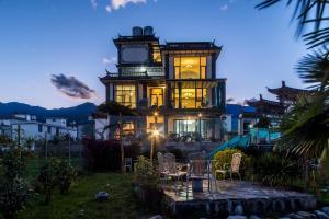 Dali Bai Cao Garden Theme Inn, Alloggi in famiglia  Dali - big - 121