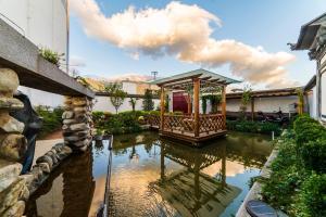 Dali Bai Cao Garden Theme Inn, Alloggi in famiglia  Dali - big - 122