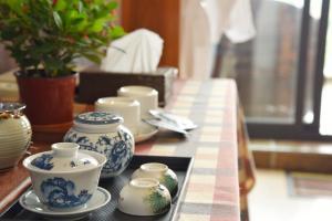 Dali Bai Cao Garden Theme Inn, Alloggi in famiglia  Dali - big - 34