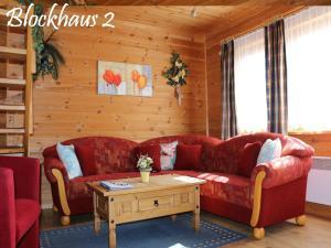 obrázek - Der-Fuchsbau-Blockhaus-2-Hunde-willkommen