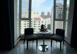 Weihai Haikuo Tiankong Seaview Inn, Appartamenti  Weihai - big - 2