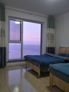 Weihai Haikuo Tiankong Seaview Inn, Appartamenti  Weihai - big - 10