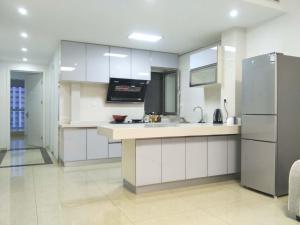 Weihai Haikuo Tiankong Seaview Inn, Appartamenti  Weihai - big - 11