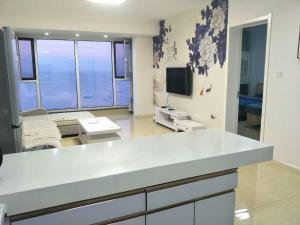 Weihai Haikuo Tiankong Seaview Inn, Appartamenti  Weihai - big - 12