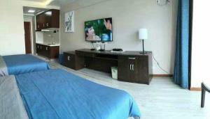 Weihai Haikuo Tiankong Seaview Inn, Appartamenti  Weihai - big - 13
