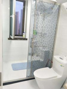 Weihai Haikuo Tiankong Seaview Inn, Appartamenti  Weihai - big - 14