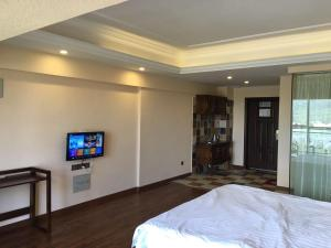 Zunke Zhuagnyuan Yuhai Apartment, Appartamenti  Dongshan - big - 8