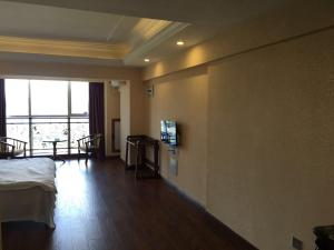 Zunke Zhuagnyuan Yuhai Apartment, Appartamenti  Dongshan - big - 7