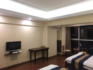 Zunke Zhuagnyuan Yuhai Apartment, Appartamenti  Dongshan - big - 6