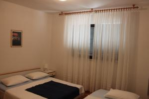 Apartment Ela, Apartmanok  Povljana - big - 13