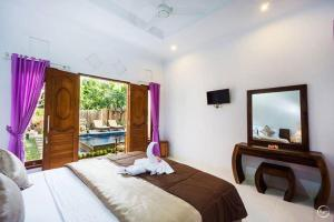 Kailash Garden Home Stay, Privatzimmer  Nusa Lembongan - big - 54