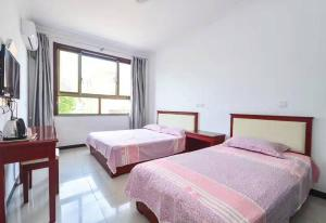 Beidaihe Hotel Langqinyu, Appartamenti  Qinhuangdao - big - 4