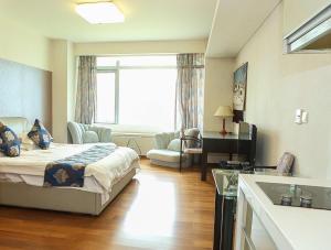 Tianjin Jinta International Xinyueyuan Hotel Apartment, Apartmány  Tianjin - big - 28