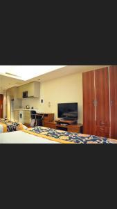 Tianjin Jinta International Xinyueyuan Hotel Apartment, Apartmány  Tianjin - big - 25