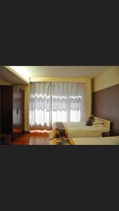 Tianjin Jinta International Xinyueyuan Hotel Apartment, Apartmány  Tianjin - big - 18