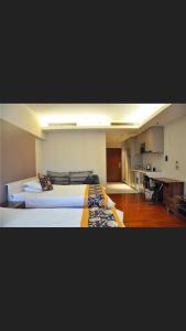 Tianjin Jinta International Xinyueyuan Hotel Apartment, Apartmány  Tianjin - big - 16