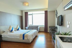 Tianjin Jinta International Xinyueyuan Hotel Apartment, Apartmány  Tianjin - big - 12