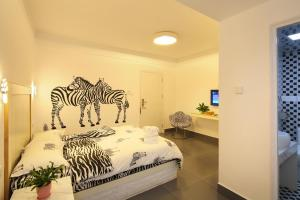 Hainajie Boutique Guesthouse, Affittacamere  Sanya - big - 13