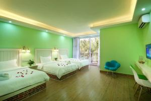 Hainajie Boutique Guesthouse, Affittacamere  Sanya - big - 17