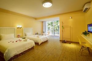 Hainajie Boutique Guesthouse, Affittacamere  Sanya - big - 26