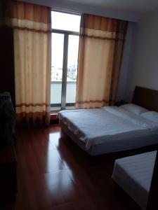 Hai Kuo Tian Kong Inn, Отели  Zhoushan - big - 1