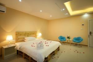 Hainajie Boutique Guesthouse, Affittacamere  Sanya - big - 27