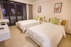 Baorui Railway Boutique Apartment, Hotely  Sanya - big - 2