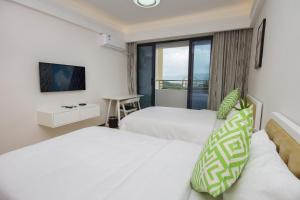 Baorui Railway Boutique Apartment, Hotely  Sanya - big - 4
