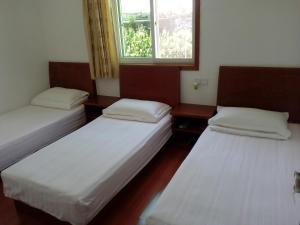 Hai Kuo Tian Kong Inn, Отели  Zhoushan - big - 16