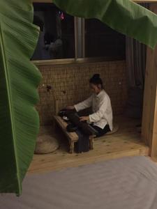 Jing Pu Plant Theme Hostel, Хостелы  Jinghong - big - 93