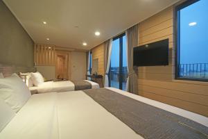 Benikea I-Jin Hotel, Hotel  Jeju - big - 47