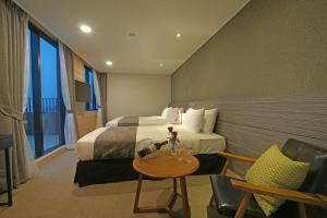 Benikea I-Jin Hotel, Hotel  Jeju - big - 48
