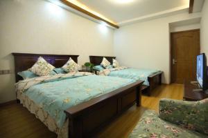Putuo mountain Sifang Ju Apartment, Appartamenti  Zhoushan - big - 5