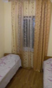 Guest House Mandarin, Affittacamere  Alakhadzi - big - 14