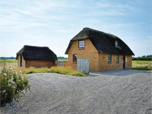 A Picture of Holiday Home Ulfborg with a Fireplace 6