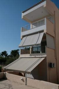 Seaside Maisonette in Afroditi Apartments, Ville  Melission - big - 12